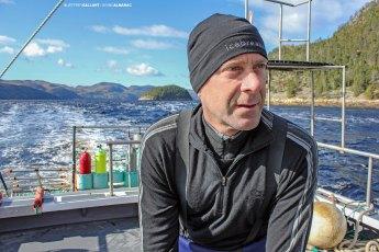 Mario Cyr between dives during a film shoot in the Saguenay Fjord. Photo © Jeffrey Gallant | Diving Almanac