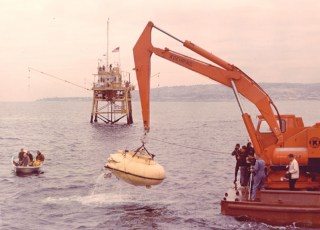 Cousteau's DS-2 is lifted out of the water after a dive off California. Photo by U.S. Navy (Public Domain)