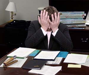 Frustrated_man_at_a_desk_(cropped)2