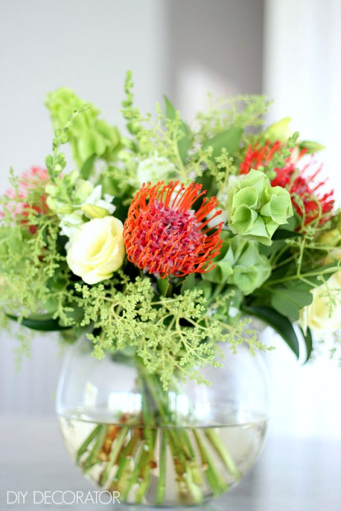 Christmas Flower Arrangement - Make a flower arrangement that will impress your guests with these expert florist tips.