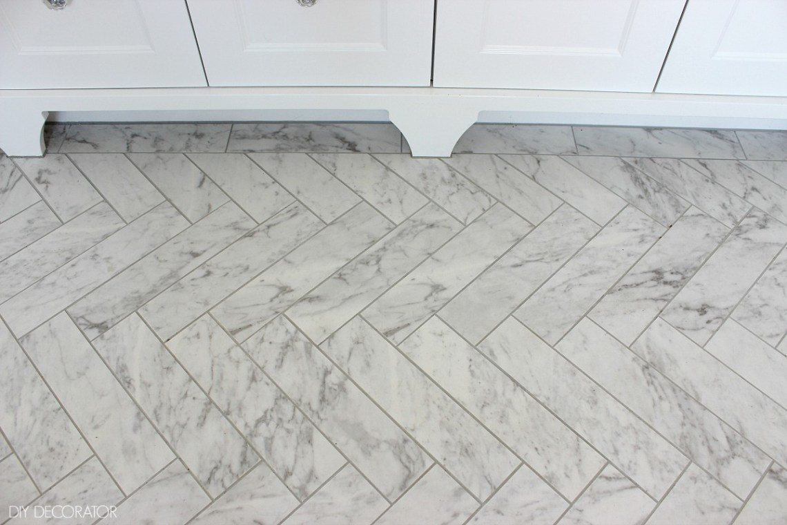 Classic ensuite reveal herringbone tiles