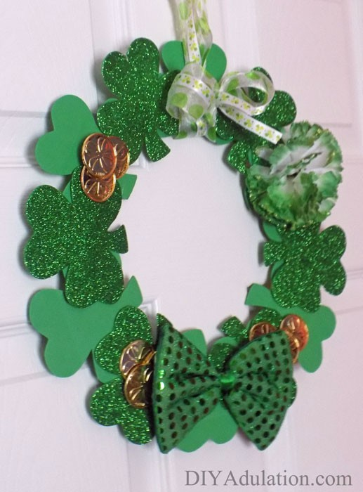 Holiday decor doesn't have to break the bank. Find out how to make this awesome dollar store St. Patrick's wreath for the change in your couch!
