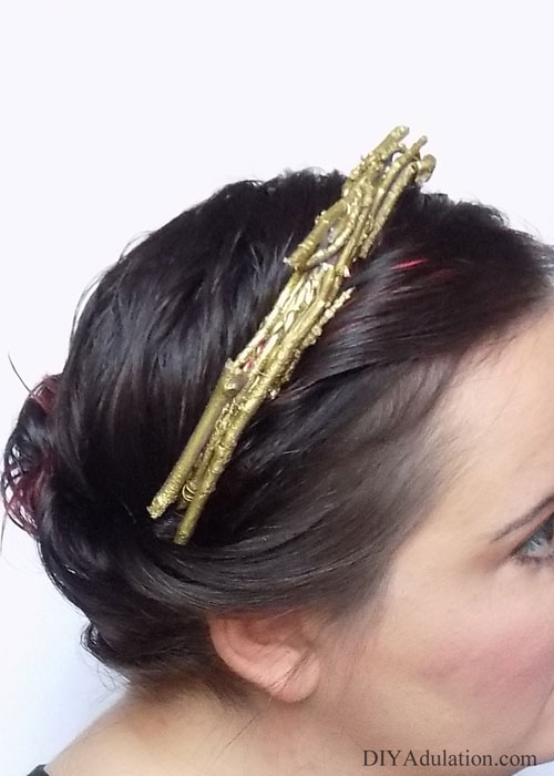 Take your hair from blah to wow easily with this DIY golden twig crown. Use it to instantly upgrade your day outfit or weave it with a glam holiday up-do.