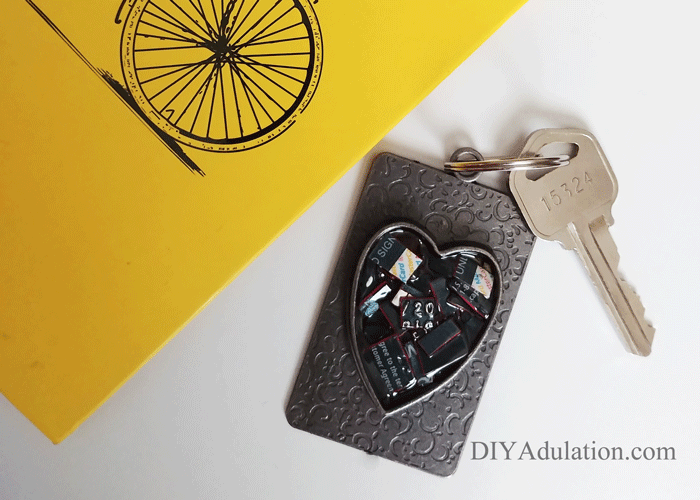 Heart Credit Card Keychain next to Yellow Notebook