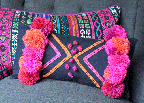 Colorful Boho throw pillows on a couch
