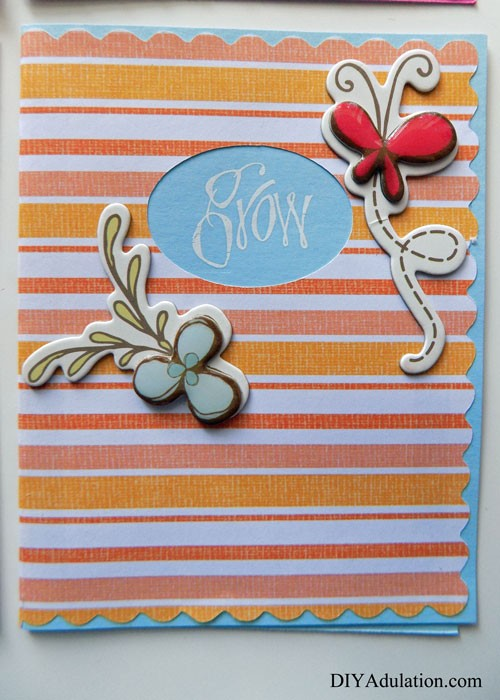 Orange Striped Greeting Card with Flower and Butterfly Embellishments