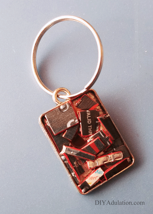 Key ring attached to rectangle keychain base