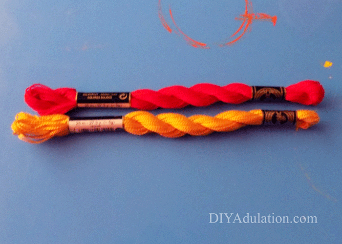 Red and Yellow DMC floss