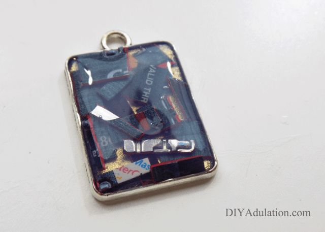 Credit Card Pieces inside rectangle keychain base covered in final layer of jewelry pendant gel with bubbles removed