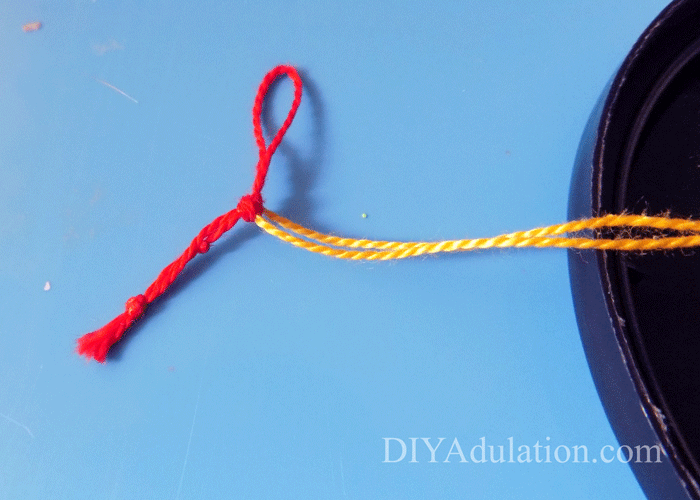 Knotted Red and Yellow Floss