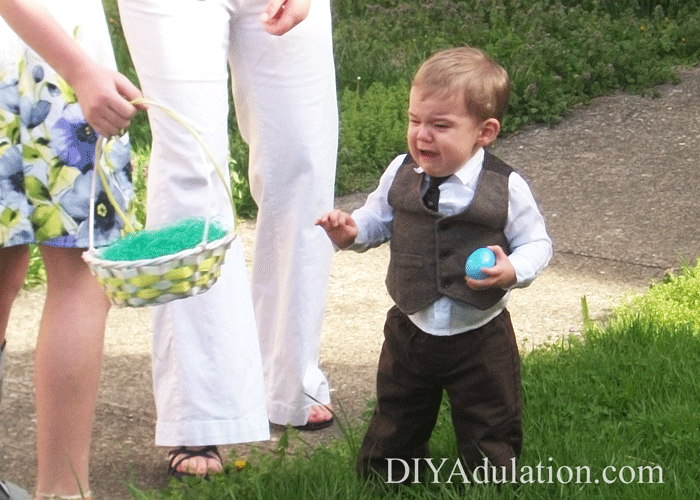 Crying Toddler carrying Easter Egg