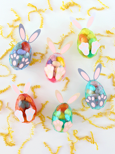 Clear Plastic Eggs Filled with candy and decorated to look like bunnies