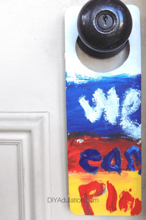 We Can Play Painted on Door Hanger on Door Knob