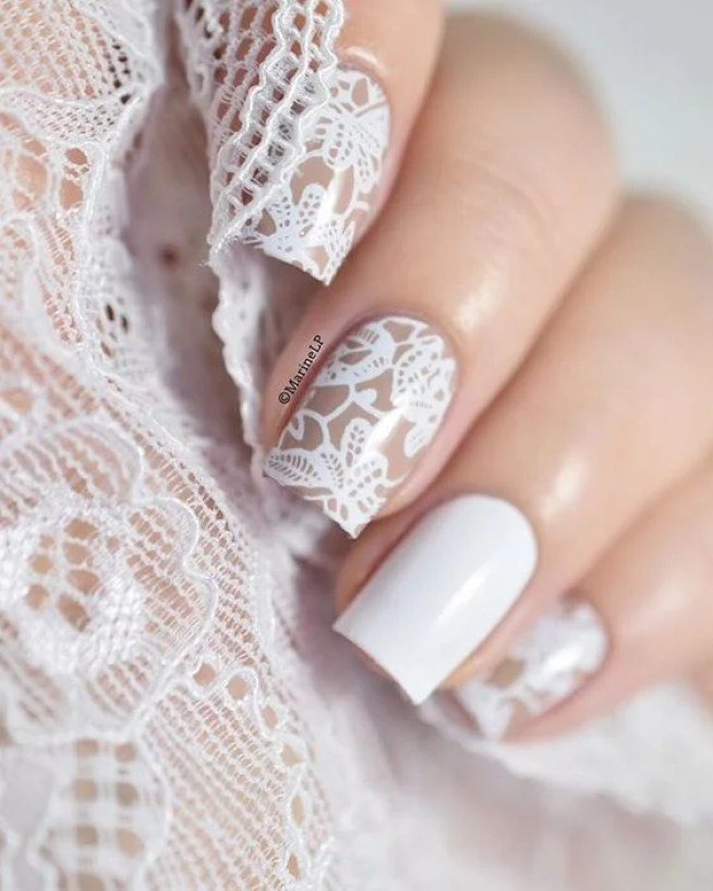 This beige and white lace nail design is so elegant!