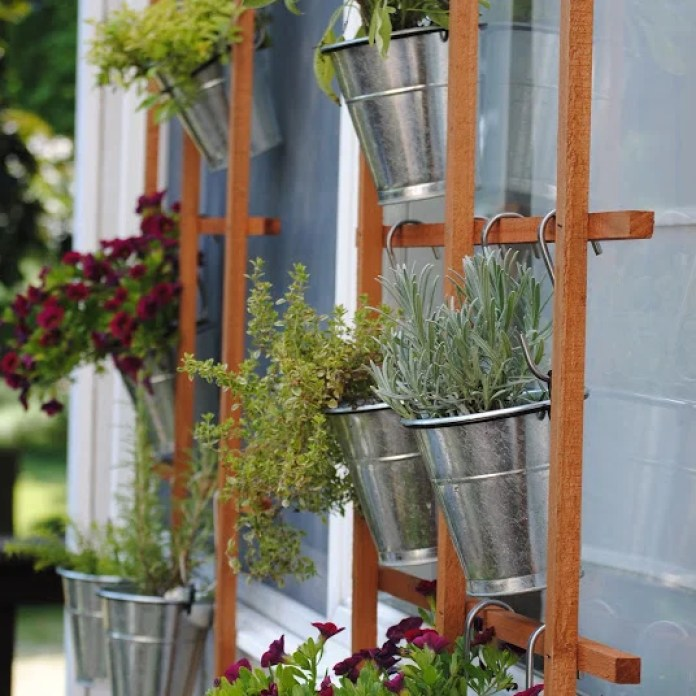 You won't believe the difference sprucing up this vertical garden made on the front of this house.