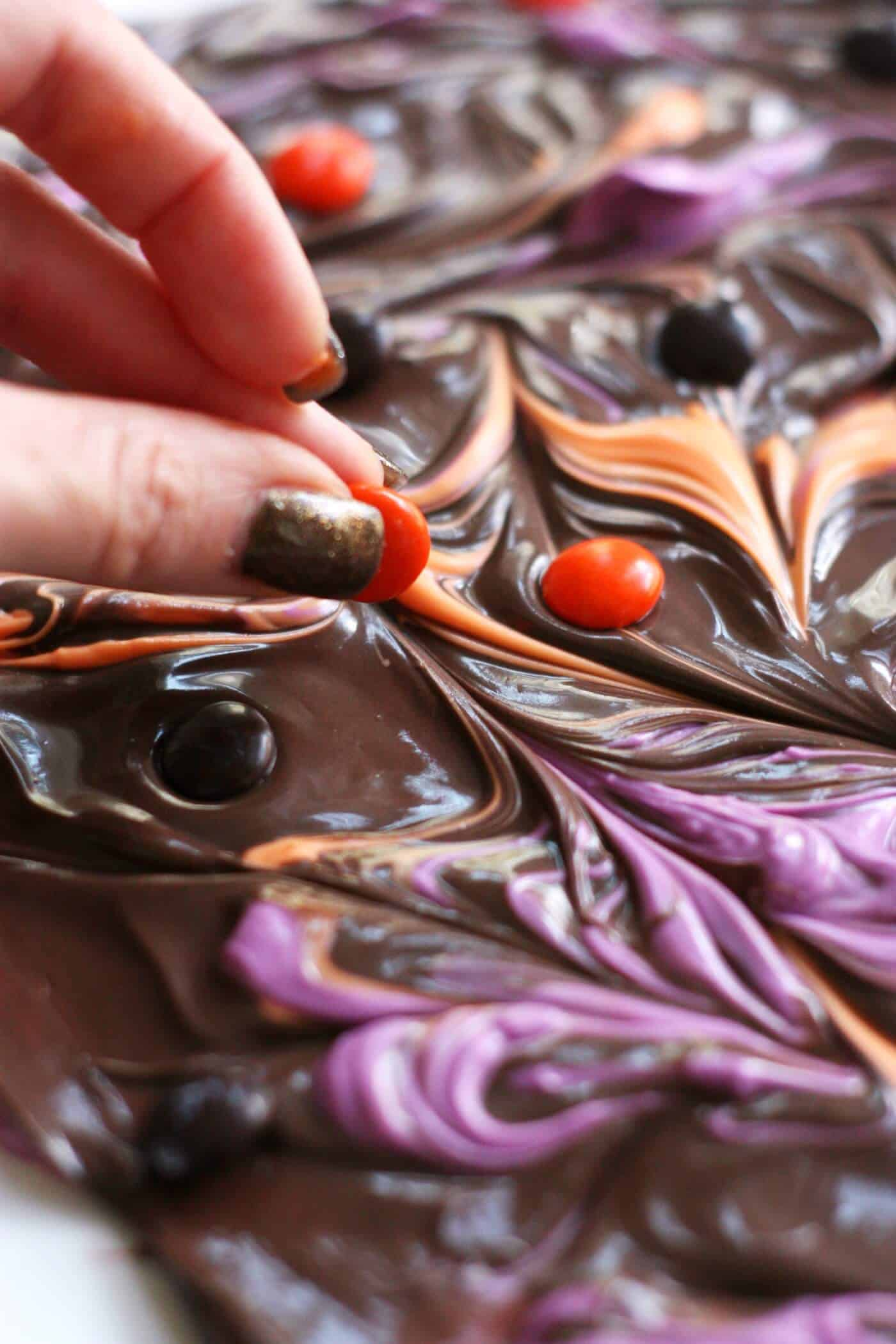 Halloween candy bark recipe - adding M&Ms