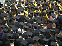 picture of graduates representing difference between graduation rates and freshman retention rates
