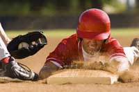 player sliding into base representing how to get recruited to play college baseball