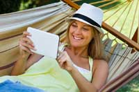 woman in hammock reading about top 50-50 college lists