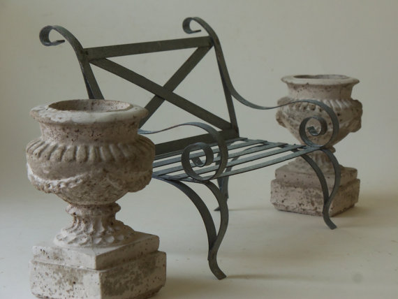 two mini cement urns and garden bench by unpotpourri