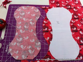 Flannel burp cloths being cut out of pink bird fabric.