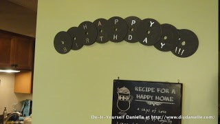 """""""Happy birthday"""" banner made from compact discs. Gray."""