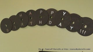Gray happy birthday banner with CDs