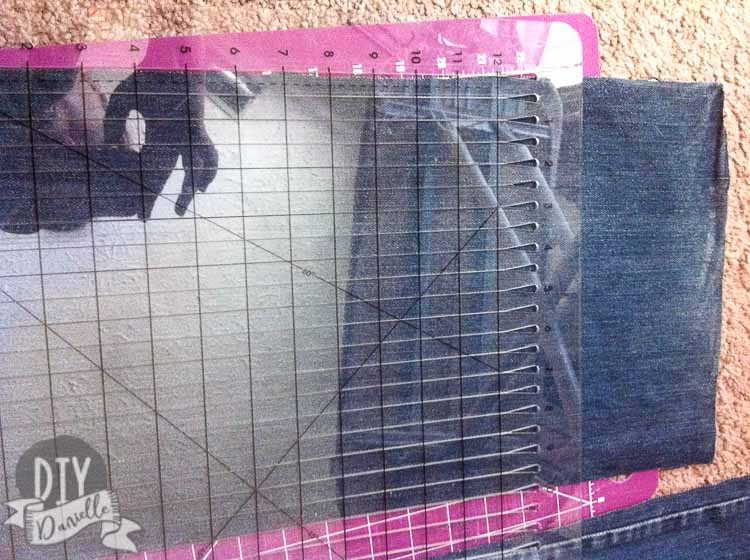 Cutting equal size strips of fabric for the skirt.