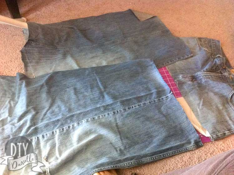 Cutting apart jeans to upcycle into a patchwork skirt.