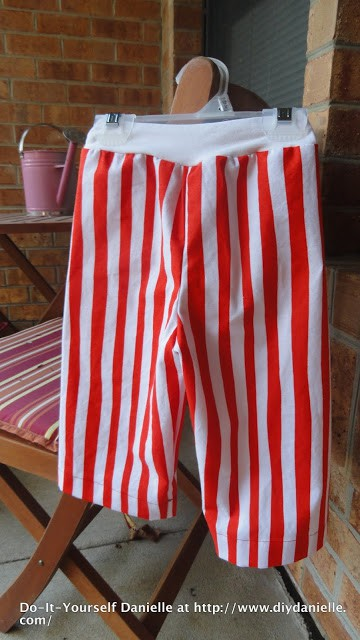 Dr. Seuss themed pant: red and white stripes, white waist band.