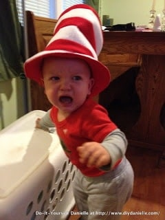 Angry baby wearing the Cat in the Hat Hat