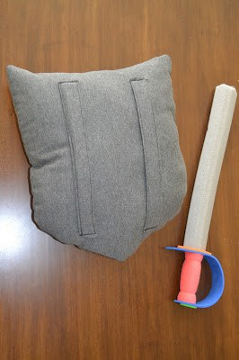 Back of the fabric shield, paired with a foam sword.