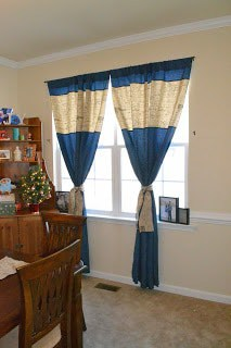 some curtains I sewed up using burlap and a beautiful blue home decor fabric I got on sale