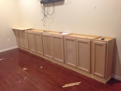 Cabinets used as a base for the entertainment center.