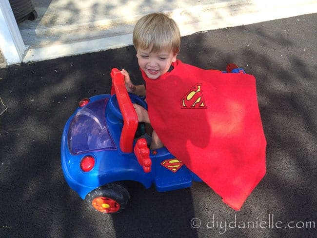 How to make a superhero cape without sewing. This is a no sew children's cape worn and a coordinating Superman car.