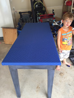 Installed gaming felt on the upcycled gaming table.