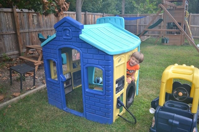 Blue and yellow plastic playhouse.