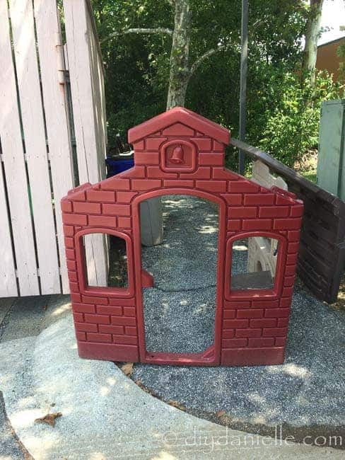 Plastic playhouse by dumpster at the gym,