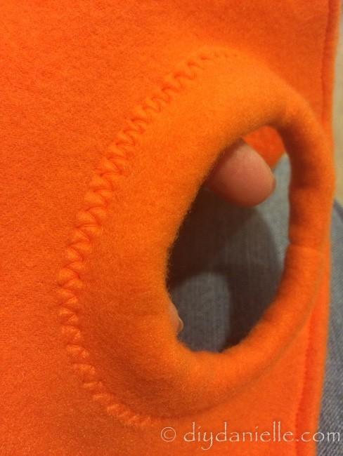 Orange bands added to the orange fleece coat.