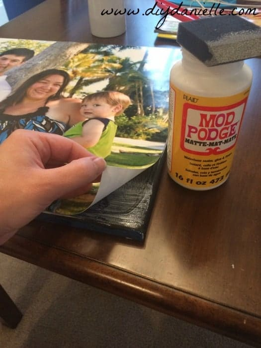 Use mod podge to add a photo to your canvas.