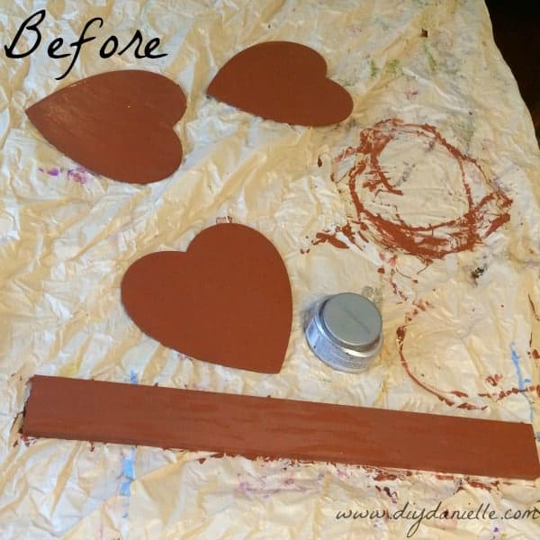 Painting the hearts for the door decoration.