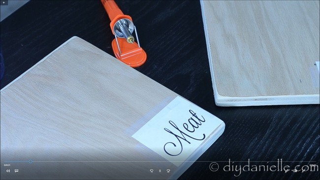 Tracing words onto cutting board to burn.