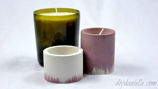 Soy candles made with nadmade concrete and wine bottle candle holders.