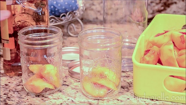 Add fruit to your mason jar.