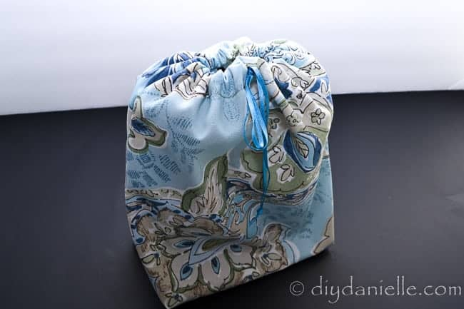 Reusable gift bag with drawstring.