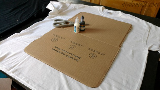 Cardboard template with other supplies for a Cards Against Humanity costume.