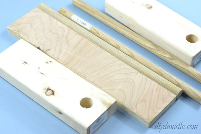 """Supplies for DIY Drawer Organizer: Dowels, 2x4s, and a Scrap of 3/4"""" plywood"""