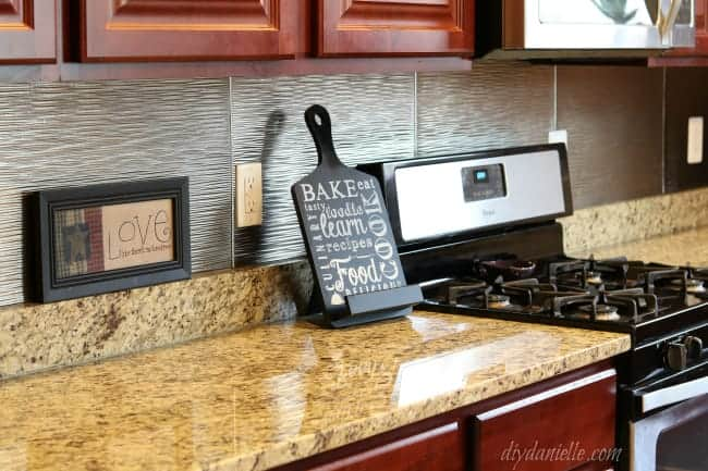 DIY Kitchen Backsplash that matches with stainless steel appliances.