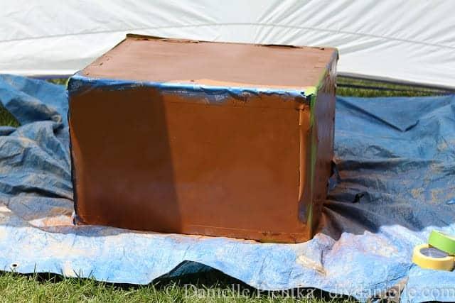 Warm caramel spray paint on a chest.