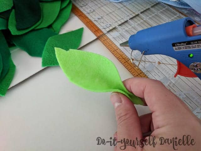 3D leaf effect made by using hot glue and pinching the bottom of the leaf.